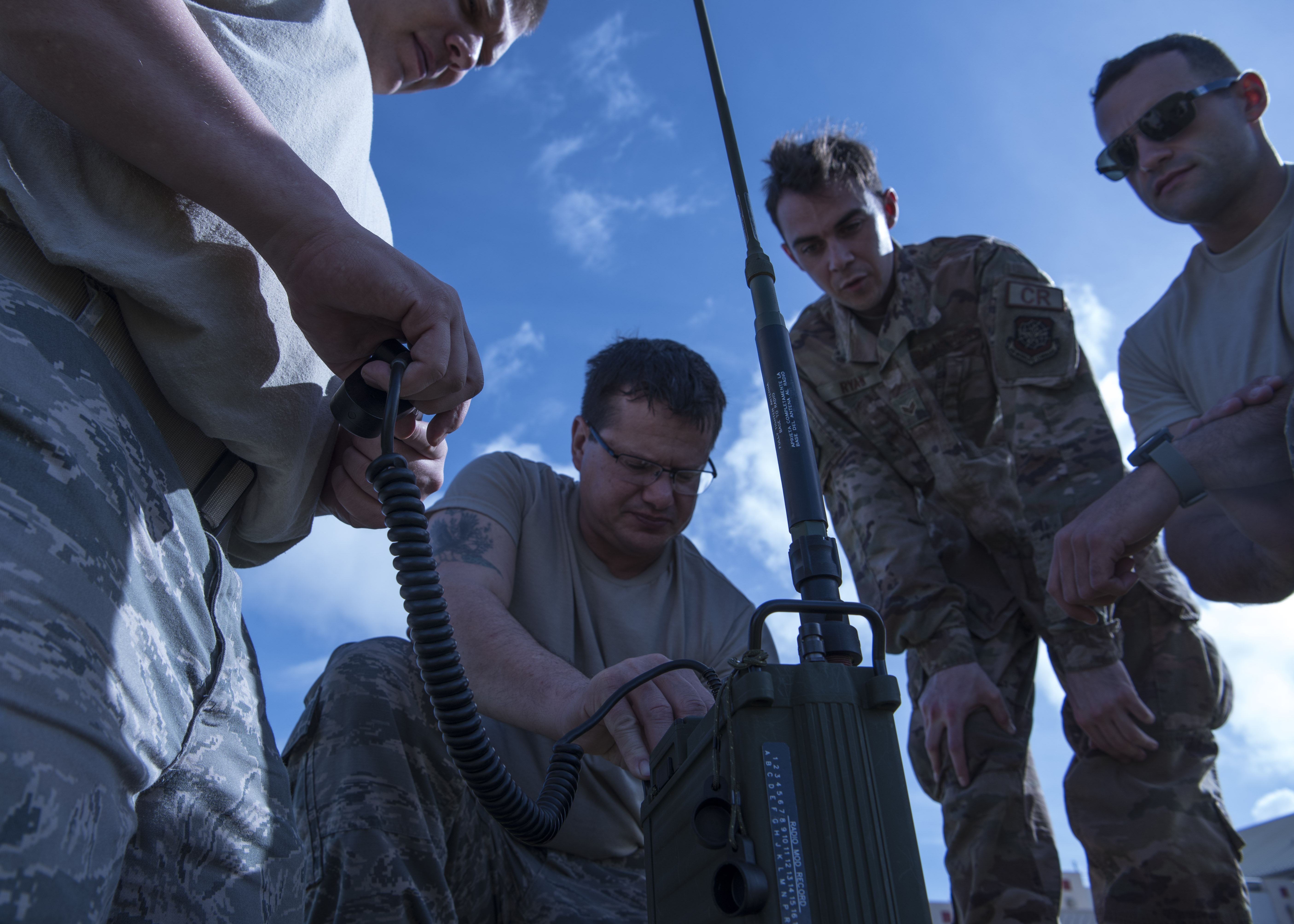 Tech. Sgt. Jared Bull, Master Sgt. Alan Plant, Senoir Airman Wyatt Ryan, Tech. Sgt. Nicholas Tyndal, radio frequency transition systems technicians from the 433rd Contingency Response Flight, 315th CRF, 821st Contingency Response Support Squadron, and 512th CRF, establish radio communications during exercise Patriot Palm, Jan 28, 2020, at Marine Corps Base Hawaii, Hawaii. Establishing communications within an hour of landing is a top priority to mobile units during exercise Patriot Palm.(U.S. Air Force photo/Tech Sgt. Della Creech)